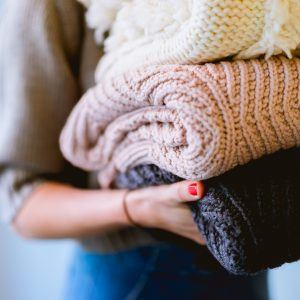 Woman doing laundry reduces willpower